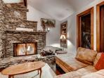 Living Room w/ stone wood burning fireplace