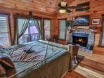 Master King on Main level with wood burning fireplace and private deck.