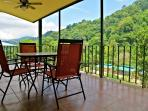 Expansive exterior deck facing the jungle forest mountain.