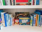 Childrens books and games kept in the bookcase.