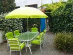 Private garden with table and chairs