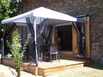 Outside dining with the gazebo in place for shade
