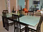 Dining table and chairs for 6.  There are 2 additional bar stool seats at the kitchen counter.