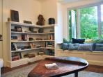 Cozy library full of books, board games and puzzles for kids of all ages