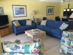 Living room with wood burning fireplace, flat screen TV, DVD with beautiful beach view and balcony.
