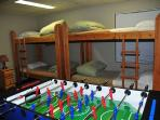 Bunks with large closet, foosball and 3 piece bathroom