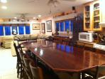 Kitchen Dining with Family is a Snap with our large family table. Extra pantry shelves under bar.