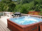 Large outdoor hot-tub on spacious deck