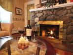 Rosevelt Luxury Suite - stone fireplace creates a delightful focal point in the sitting room