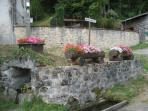 The historic village well is located directly opposite the cottage