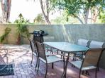 Private patio with propane grill and seating for 8