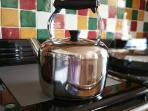 Huge farmhouse kettle lives on the hot AGA meaning tea or coffee is always at hand!