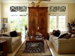 Relax in elegant family room w/ 64' Sanyo LCD HDTV/ & Sony Blue Ray DVD & elegant antique furniture.