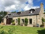 Beautiful granite-built lodge in half an acre of south facing grounds.