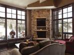 View of living room with gas fireplace, 50' TV/DVD, and 6-seat dining room table  in Deer Valley Penthouse - Deer Valley