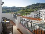 The shady balcony off the livingroom - nice to enjoy breakfast or siesta time here.