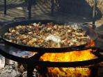 Paella cooked fresh daily at the beach .