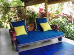 chaise lounge on the covered porch