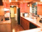 Gourmet kitchen with gas range, oven, full size refrigerator Maytag washer/dryer