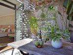 Your shaded, outdoor breakfast area