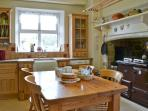 The farmhouse kitchen is well equiped and has two cookers and two fridges for the larger party.