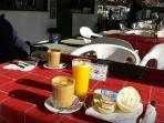 A simple breakfast we enjoy at Ayo, excellent coffee, fresh orange juice