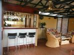The Sundowner Bar and deck lounging area - in the treetops overlooking the Bay