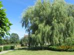 Beautiful arbor and shared manicured garden of over one acre.