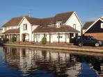 Sandringham Cottage and Peninsula Cottages Wroxham from the Loynes Marina, Wroxham.