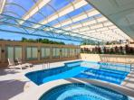 The complex boasts two swimming pools, a spa and his and hers saunas