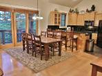 View of gourmet kitchen, dining area, and private deck in Town Pointe Treasure - Park City
