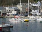 Lyme Regis harbour. The apartment is the nearest building to the harbour with the tinted windows.