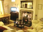 Sitting/Dining Room: Mini Inglenook & multi-fuel stove, Freesat TV, CD/DVD, books, maps, guides etc