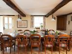 The original beams and an open plan aspect complimented with antique furniture