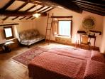 Attic bedroom in torreta  with 2 twin beds. A kid's favorite!! Find the 1796 inscription!