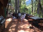 Spacious back deck facing the river and Tahoe National Forest with gas barbecue