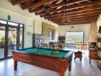 Lobby with pool table, TV corner and library