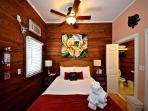 Coral Cove features wooden walls, large ceiling fan and AC