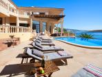 The pool, sea and villa