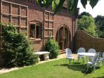 Front of Wisteria Lodge with enclosed private garden