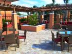 Outdoor poolside lounge area. Perfect for catching some sun, reading a book or watching the kids