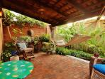 West Wing...Enter your private patio, feel the tropics with the bananas, palms and ferns