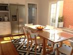 Afternoon sun in the kitchen with the French doors opened to the courtyard