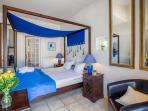 The dark blue bedroom