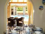 Dining table and sitting area by the pool