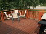 deck with bbq and dining area