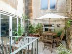 Enjoy a glass of wine in the pretty patio garden