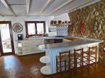 Full equipped country kitchen with direct access to dining terrace wit barbecue