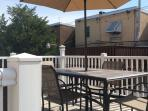 Sundeck available for outdoor dining with small garden and barbeque grill facing Citizen's Bank Ball