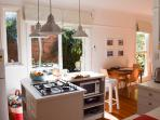 Kitchen and breakfast bar with garden views